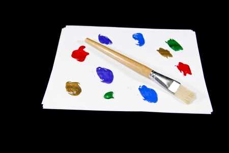 A paint brush and colorful paints create a painters palette. Stock Photo - 17923925