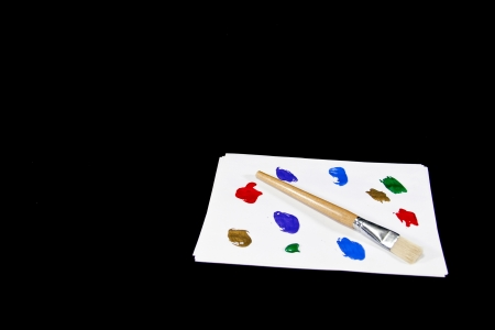 A paint brush and colorful paints create a painters palette. Stock Photo - 17923919