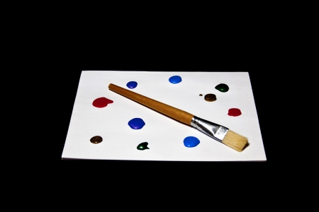 A paint brush and colorful paints create a painters palette. Stock Photo - 17923924