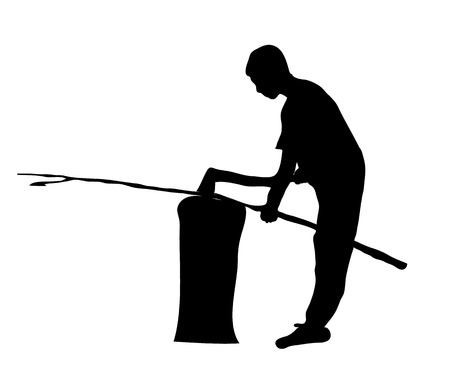 Silhouette of a man who splits wood on the chopping block