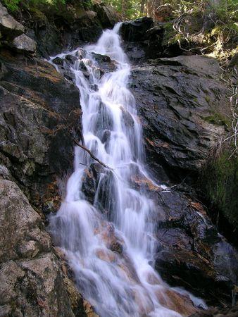 Waterfall over Ross Lake Stock Photo