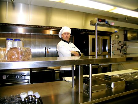 Chef on Commercial Industrial Kitchen Line, Bright and Shiny Imagens