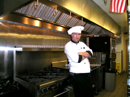 chefs show:           Chef on Commercial Industrial Kitchen Line, Bright and Shiny