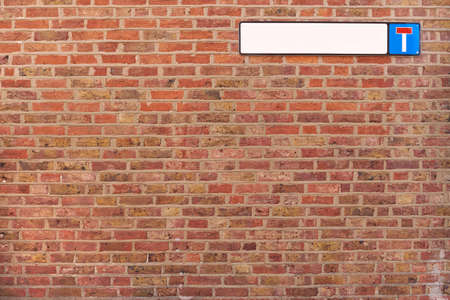 Brick wall background texture with cul-de-sac sign, good for graffiti Stock Photo