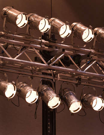 stage lighting: A bank of lit stage lights, or spotlights, for theater, entertainment, or indoor sporting events.