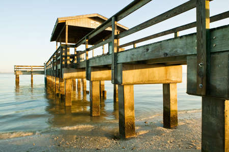 The view from beneath an old wooden fishing pier on Sanibel Island, Florida and looking out over The Gulf Of Mexico. Stock Photo - 3871196