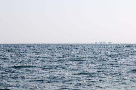 horizont: Oil Rigs far on the horizont line.  Stock Photo
