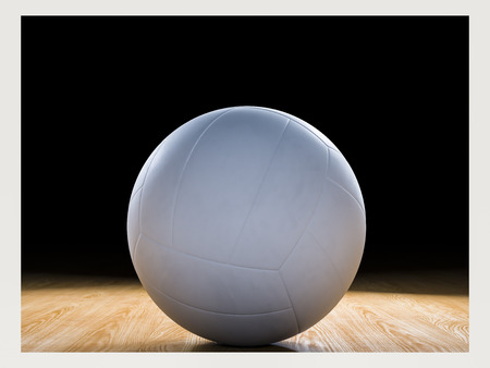 Volleyball court wooden floor with ball isolated on black with copy-space Stockfoto