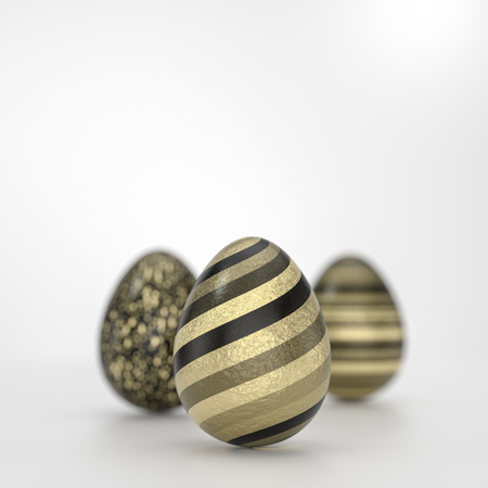 Three Easter eggs art concept with striped black golden decoration in close-up against grey background with copy space Stock Photo - 120495554