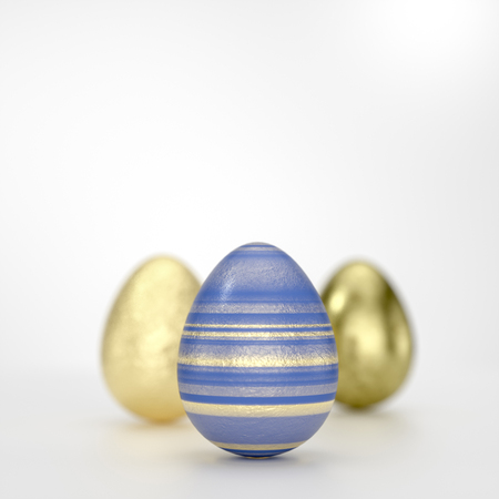 Three Easter eggs art concept with striped black golden decoration in close-up against grey background with copy space