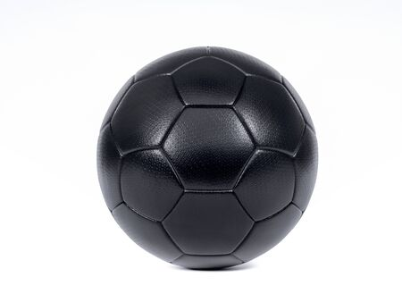 Isolated modern black football or soccer ball centered on a white background with drop shadow