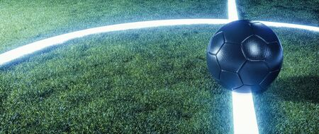Neon soccer field with ball on glowing lines on a green grassy sports field at night in a panorama banner with copy space for sports or football themes
