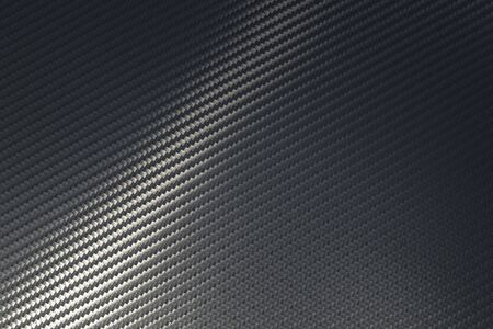 Bended surface of grey woven carbon fibre composite sheet. Texture and pattern background. Modern technology and material concept... Imagens