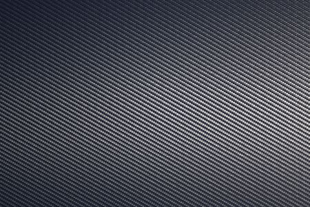 Grey woven carbon fibre composite texture background. Sheet of future light raw material. Modern technology and material concept.