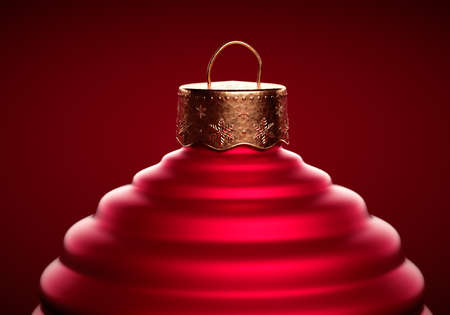 Closeup of Red Christmas ball top with textured cap. Horizontally striped Christmas ornament against dark red background. Christmas decoration, festive atmosphere concept.