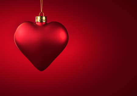 Red heart Christmas ornament. Bauble hanging on golden thread on red background. Christmas decoration, festive atmosphere concept. Copy space. 免版税图像