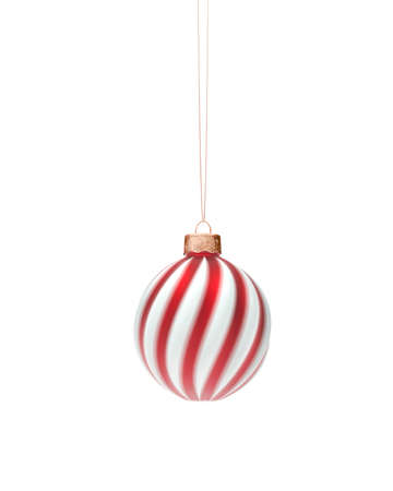 Red and white spiral twisted Christmas bauble hanging on string. Isolated on white background. Christmas decoration, festive atmosphere concept.