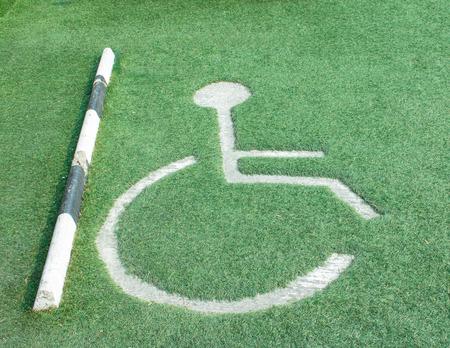 paralyze: Cripple wheelchair sign and arrow sign on the road;cripple icon