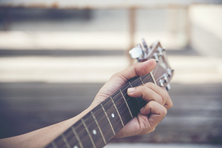 Man hand playing guitar Stock Photo