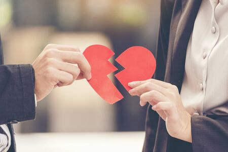Grief divorce couple holding broken heart. Unhappy relationship hurt feeling for lover. valentine concept.