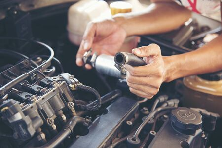 Mechanic Car Service in automobile garage auto car and vehicles service mechanical engineering. Automobile mechanic hands car repairs automotive workshop service center. Services car engine machine. Imagens
