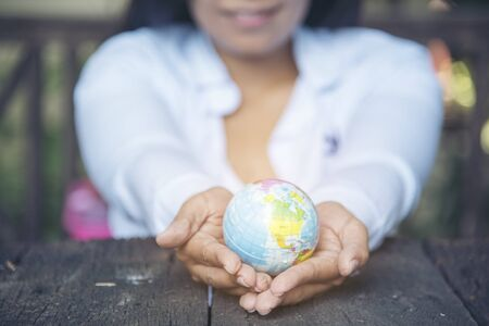 Global globe on woman hands. Development Concept.
