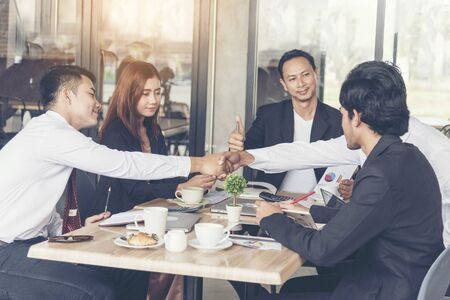 Business Marketing Team Collaborate in office. Group of people meeting working together.Marketing communications strategy business office.Business Teamwork conference meeting outside.Business Concept