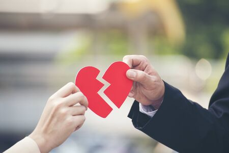 Heart broken. unlucky in love abstract sign of unhappy. close up hands of business people holding red heart. I am sorry concept.