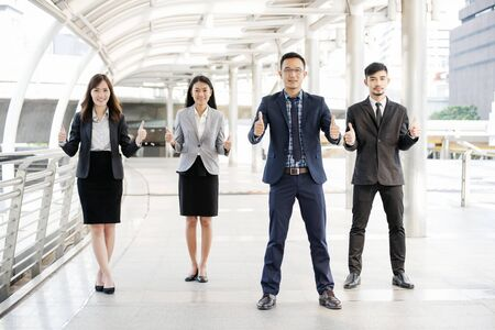 Asian diversity multicultural business corporate people group outdoor in modern city. Diversity coworkers team talking trust in partnership. Consultant colleague business people meeting concept