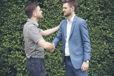Congratulation to collaboration partner after sign on contract. Diverse Businessman shake hands together with businessman to introduce meeting. Trustworthy student friends meeting. Business Concept