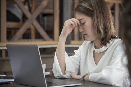 Woman nervous frightened to lost job infected corona covid-19 virus infectious.Working woman migraine headache sick from stress exhausted office syndrome  Economic crisis world epidemic infection Stock Photo