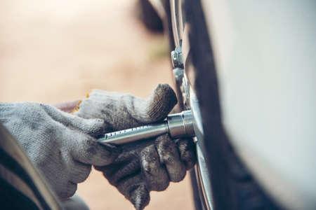 Mechanic man car service repair automobile garage autocar vehicles service mechanical man engineering. Automobile mechanical close up hands fixing car repairs. Mechanic technician workshop center Stock Photo