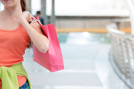 Shopaholic Women holding shopping bags ,money ,credit card person at shopping malls.Fashionable Woman love online website with sales tag on black Friday. E-commerce fashion digital marketing lifestyle Zdjęcie Seryjne