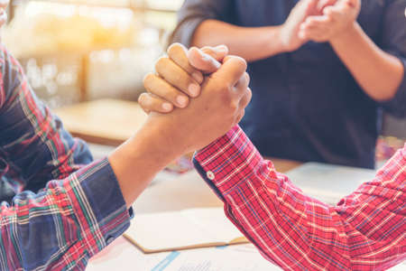 Team Business Partners Giving Fist Bump after complete a deal. Successful Teamwork Partnership in an office. Businessman with hands together. industry business concept.