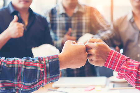 Team Business Partners Giving Fist Bump after complete a deal. Successful Teamwork Partnership in an office. Businessman with hands together. industry business concept Banco de Imagens
