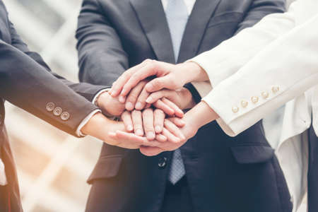 Teamwork Together Concept. Group of diversity people high five on air to greeting power of tag team. Multiethnic people group working togetherness. Volunteer collaboration in Business Team success