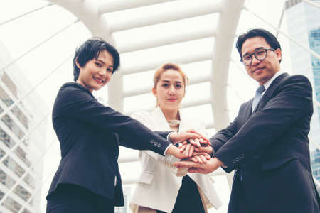 Mission vision business team building identity corporate teamwork industry and workforce.  Mission and strategy for business people holding hands together group of leadership. Mission Vision Concept. Banco de Imagens