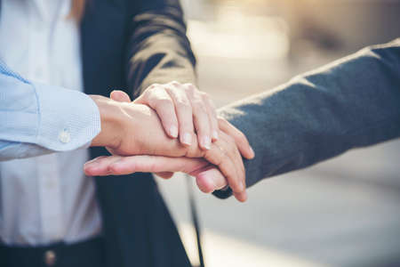 Group of diversity people with success partnership fist bump of hands together to show power and unified teams in office. Business teamwork trust in partner. Teamwork Concept.