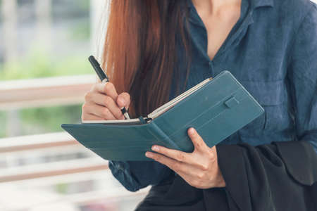 Agenda of planner woman schedule and organize appointment 2020 Calendar Event. Smart Business woman note and schedule to set timetable organize schedule. Woman hands writing on Agenda.Timeline concept