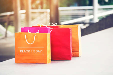 Shopping bags of women crazy shopaholic person at shopping mall. Woman love online shopping website with sales tags. E-commerce Bag Concept. Stockfoto