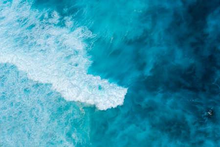 Summer tropical beach white sand blue sea summertime on sunny day. Sea coast beach scenery foamy wave on the beach waves of blue sea tropical ocean sand. Travel holidays vacation seaside turquoise .
