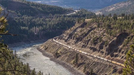 Long Train Laboring through the Mighty Fraser Canyon photo