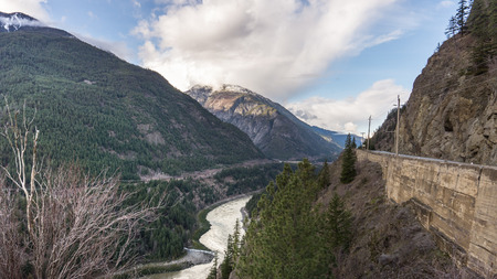 power lines: Railroad highway and Power Lines through the Fraser Canyon Stock Photo