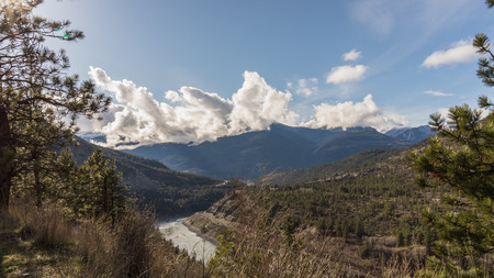 fraser river: The Fraser River flowing West through the Fraser Canyon