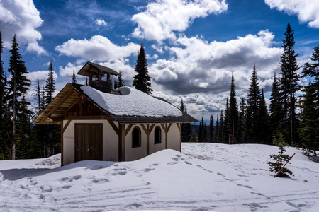 A small chapel in the high alpine region of the Sun Peaks ski resort in British Columbia photo