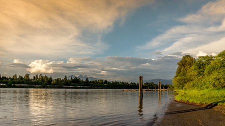 fraser river: Sunset over the Fraser River near Fort Langley showing tie downs for log booms Stock Photo