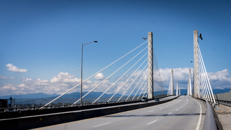 The Golden Ears Bridge over the Fraser River connecting the towns of Langley and Maple Ridge in the Fraser Valley of British Columbia