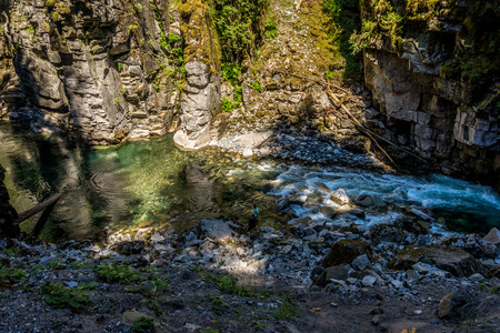 othello: The Coquihalla River as it winds its way through the canyon at the Othello Tunnels park Stock Photo