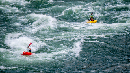 rapid: Kayaking in the White Water rapids of the Fraser River in the Fraser Canyon in British Columbia Stock Photo