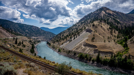 The Fraser River as it Flows through the Fraser Canyon in British Columbia Canada Фото со стока
